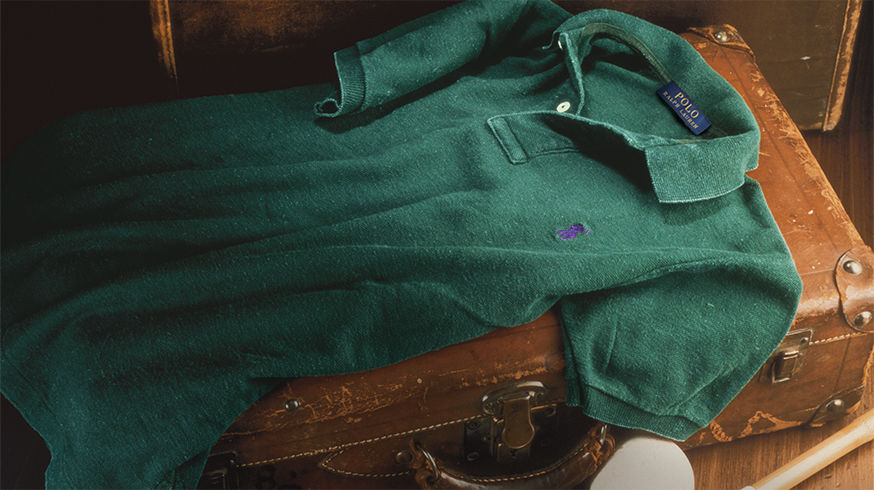 Green polo shirt with purple signature embroidered pony