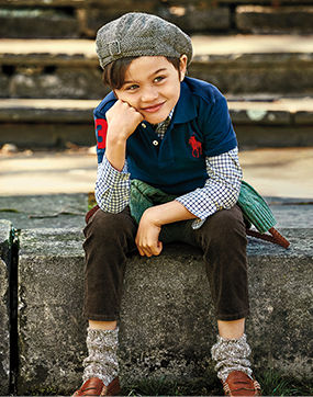 Boy layers navy Big Pony Polo shirt over long-sleeve patterned shirt