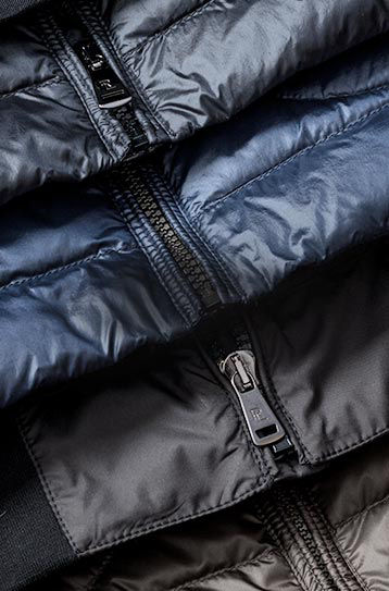 Detail of zippers on four performance jackets