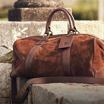 Brown suede duffel bag with leather trim
