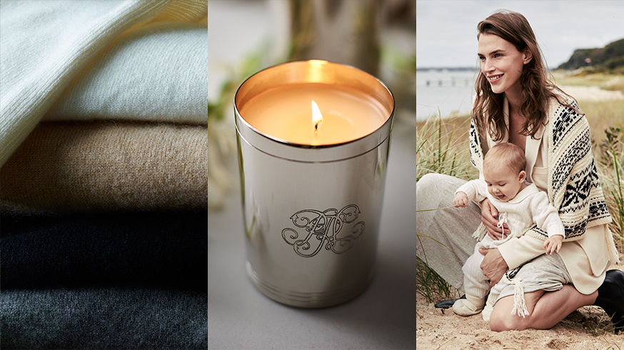 Folded sweater. Silver votive candle. Woman in cream outfit holds baby