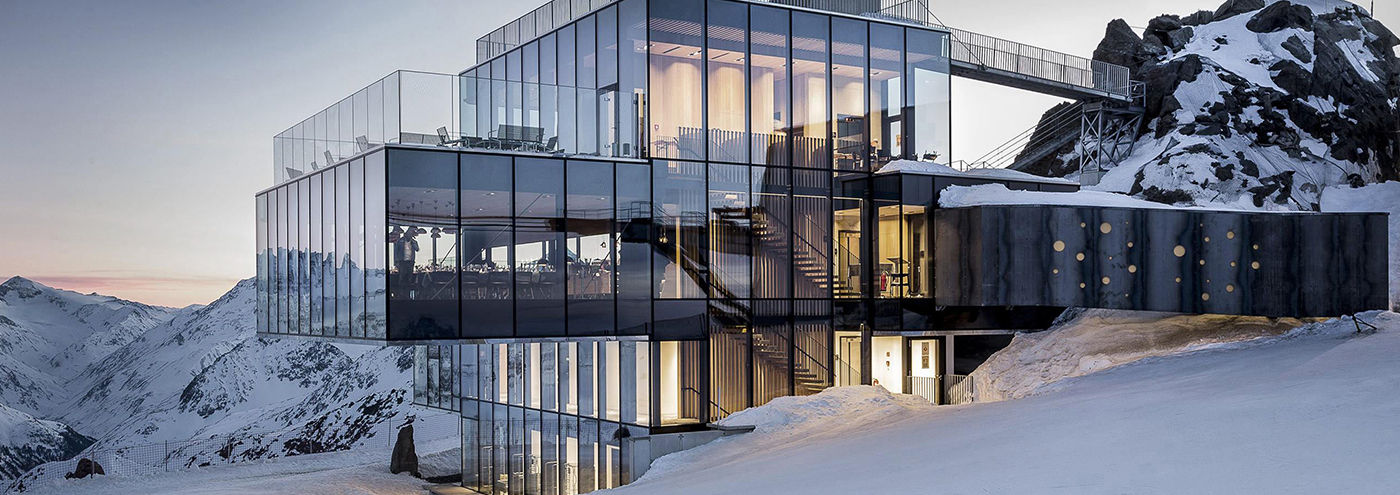 Cube-shaped restaurant & meeting space tucked into the Alps in Austria